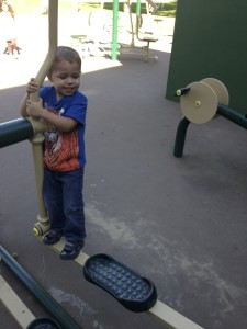 Getting out that energy playing on the exercise equipment at the park