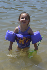 My sweet niece playing in the river