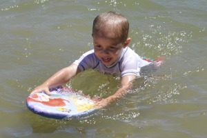 "Parker playing on his ""surf board"""