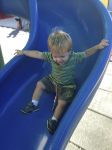 Austin enjoying the big kid slide