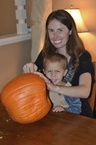 Mommy and Parker carve our pumpkin