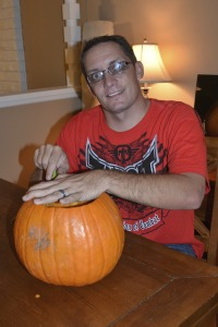 Clint carves his pumpkin