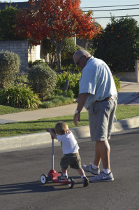 Grandpa helps Austin with his scooter