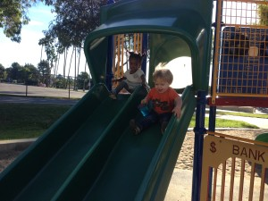 Austin and Aya ride down the slide together