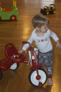 Austin gathers up small cars on his bike