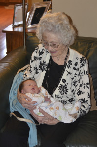 Holding newborn Austin