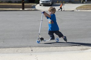 Austin cruising on his new scooter