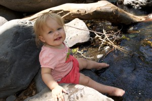 Dipping her toes into the stream