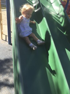 Going down the slide by herself