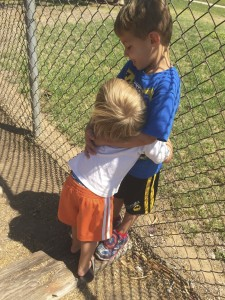Austin happily hugging Parker when we picked him up from school