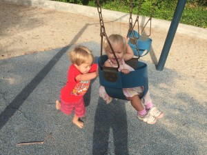 Austin pushing Audrey in the swing