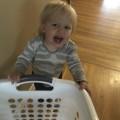 Audrey pushing a laundry basket